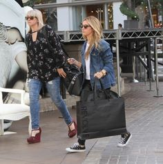 """NEWS, CANDIDS:  On 17 November 2014, Ashley Tisdale is photographed by paparazzi in Los Angeles, as he was leaving the shop """"Revolve"""" at The Grove, after shopping with her sister Jennifer."""