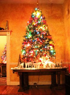 Christmas tree on table, with Putz village