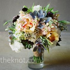Chelle's bouquet had peach cymbidium orchids, peach stock, white lisianthus, burgundy scabiosa, and succulents. from the album: A Traditional Wedding in Austin, TX