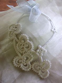 A White Shamrock Irish Crochet Necklace. Inspiration - link may be bad so try http://crochetology.net/category/pendantnecklace/page/1/ and http://crochetology.net/category/pendantnecklace/page/2/