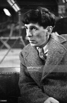British composer Sir Michael Tippett (1905 - 1998) listening to rehearsals of his Oratorio, 'A Child of Our Time', at the Corn Exchange, Bedford. Original Publication: Picture Post - 1920 - A Composer Listens To His Own Oratorio - pub. 1945