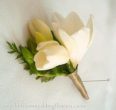 The readers will wear pinned on corsages of white freesia wrapped in twine