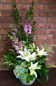 Floral arrangement created by Jackson Florist. #fresharrangement #flowers