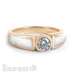 """Blushing Shell - Muse"" - White mother of pearl inlaid into rose gold, with a center diamond of your choosing. 