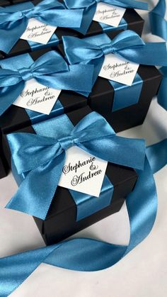 Dusty blue personalized wedding favor box with satin ribbon bow and custom names, Elegant gift boxes make a unique way to thank guests for attending your special day. #welcomebox #giftbox #personalizedgifts #weddingfavor #weddingbox #weddingfavorideas #bonbonniere #weddingparty #sweetlove #favorboxes #candybox #elegantwedding #partyfavor #bluewedding #giftboxes #navybluewedding #dustybluewedding #uniqueweddingfavors #uniqueweddingideas #palebluewedding