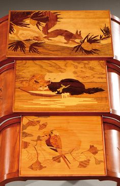 A set of three tinted beech wood nests of tables with an exotic wood marquetry of birds, a squirrel and cats.Signed«Gallé». Circa 1900.