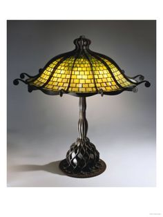 I never much cared for Tiffany lamps until I saw this one. Oddly, the Tiffany octopus lamp has twelve tentacles. Tiffany Stained Glass, Stained Glass Lamps, Tiffany Glass, Leaded Glass, Louis Comfort Tiffany, Antique Lamps, Vintage Lamps, Vintage Lighting, Octopus Lamp
