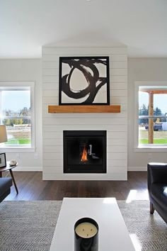 White shiplap fireplace surround with wood mantle Woodsman 11 West Coast Homes Basement Fireplace, Fireplace Redo, Shiplap Fireplace, Small Fireplace, White Fireplace, Fireplace Remodel, Living Room With Fireplace, Fireplace Surrounds, Fireplace Design