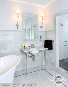 6x12 marble tile wainscotting framed wiht marble chair rail tile in bathroom - Normandy Remodeling