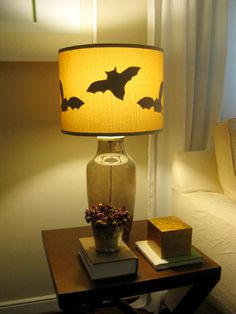 we took another little Martha Stewart trick and added black bat silhouettes to the insides of our living room lamps