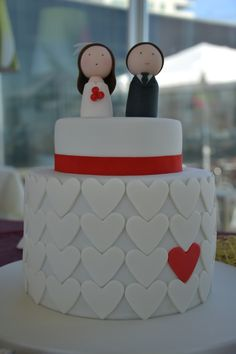 I love this wedding cake! The little people that represent the bride and groom are adorable and the cake itself is so simple and clean with just that pop of color!