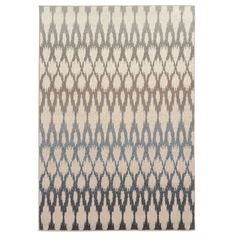 Complete any contemporary decor with the fashionable ikat design 5'3 x 7'3 rug in an ivory, taupe, sage, slate blue and charcoal finish. This machine-woven area rug is durable with easy care and cleaning.