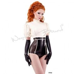 Sublime red hair model in gorgeous Westward Bound latex outfit