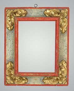 View 1: Spanish carved, gilt and polychrome frame of reverse profile with stylized leaf corners, hazzling, and marbleized panels.