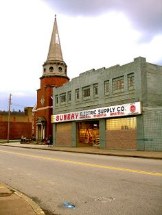 Sunray Electric, McKeesport, PA Just liked the juxtaposition of the elegant church and the everyday electric business.