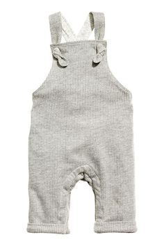 Jersey-lined dungarees: BABY EXCLUSIVE. Dungarees in soft, textured jersey with straps with decorative knots at the front that cross at the back and can be adjusted with buttons. Elastication at the back of the waist, concealed press-studs at the crotch (not in sizes 1-2Y) and sewn-in turn-ups at the hems. Jersey lining.