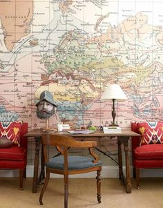 World View: Designer Daniel Sachs gave a classic Park Avenue apartment an antique and global appeal, even in the young boy's bedroom. The wallpaper behind the desk is a blown up version of an antique world map.