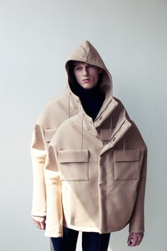 I like this witty jacket which looks like it was designed by Martin Margiela. Rei Kawakubo also sticks repetitive chunky elements to clothes which I love.