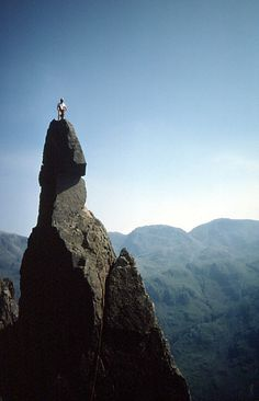 Excerp from source website: Napes Needle was first climbed (solo) by Walter Parry Haskett Smith in June 1886...    Today the original route of ascent via the Wasdale Crack (as seen in the photo...) is graded Hard Severe. The Arête follows the right-hand edge and is the least sustained route of ascent, though it too ends up with some hard moves at the top (above the Shoulder) where it joins the Wasdale Crack route and is also graded Hard Severe.