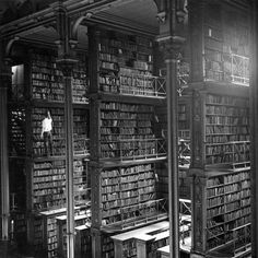 Iconic Historical Photographs From United States. A man taking a book off the shelf in Cincinnati, Ohio, main library in Photo by: Public Library of Cincinnati and Hamilton County. Cincinnati Library, Cincinnati Usa, Detroit Library, Cleveland, Main Library, Dream Library, Future Library, Modern Library, Library Design