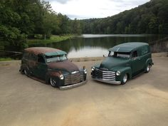 A pair of slammed Advanced Design Chevy's, a panel truck and a suburban.