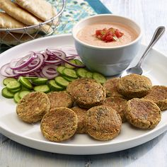 A baked version of falafel flavored with fresh parsley, garlic and cumin and served with a creamy spicy tomato-yogurt sauce