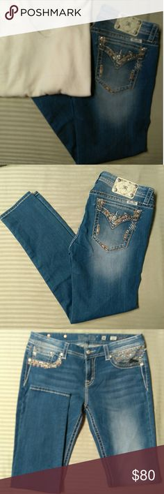 Miss Me Signature Skinny Embellished Jeans Light wash. Embellished front and back pockets. Rhinestones on corners of back pockets and front right pocket. Silver logo hardware. 85% cotton, 13% poly, 2% spandex.  Inseam 31. Miss Me Jeans Skinny
