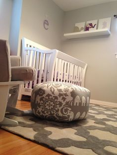 Love the #elephant #pouf in this #gray #nursery.