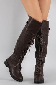 Free SH & Easy Returns! Shop Dollhouse Lace Up Combat Over-The-Knee Boots. These boots feature a round toe silhouette, lace up front, lug sole, and block heel.