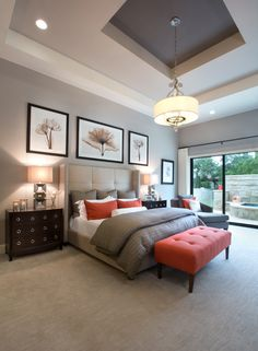 Monticello Homes. Grey bedroom pops of spiced orange, dark wood