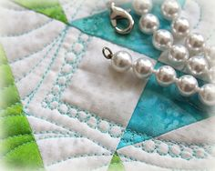 Glamming up with… a string of pearls!  I love quilting string of pearls whenever I need to glam up a look.  Here is my latest completed project… Here are pictures of glamming up with st…