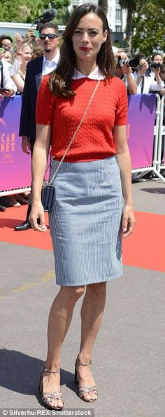 Work of art! Berenice Bejo opted for a crimson jumper and pinstriped skirt...