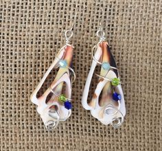 Sea shell earrings wire wrapped with by MermaidsDesignStudio