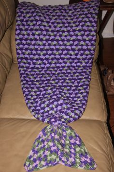 Crochet a Wearable Afghan Mermaid Tail. Free pattern. Will be difficult to print because isn't in a pdf format. The top part is a blanket, the bottom portion wraps around. Basic 5dc shell pattern.