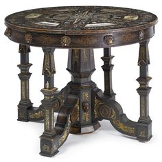 A rare spanish ebony veneered, fruitwood, engraved ivory and mother-of-pearl center table celebrating the reign of Alfonso XIImost probably Madrid ca 1885