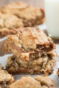 This Dulce de Leche Revel Bars recipe is fast, easy, and full of caramel and oatmeal cookie flavor! @crazyforcrust