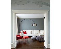 grey walls. white trim. dark floors