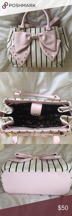 Betsey Johnson Handbag. NWOT White with black stripes satchel with pink oversized bow. Long removable strap included. Brand new never worn. Handbag has one large compartment with magnetic closing clasp. 1 zippered interior pocket and 2 small cell phone sized interior pockets. The interior is lined with black and betsey signature rose print fabric. Betsey Johnson Bags Satchels