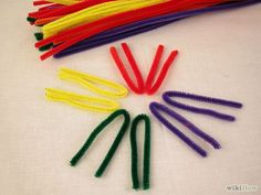 How to Make a St Brigid's Cross with Pipe Cleaners. This article will be telling you how to make a St Brigid's cross out of pipe cleaners. St Brigid is one of Ireland's patron Saints and she made a cross out of rushes to protect her from. St Bridget's Cross, St Brigid Cross, Cross Art, Pipe Cleaner Crafts, Pipe Cleaners, Craft Projects For Kids, Craft Ideas, Fun Ideas, Party Ideas