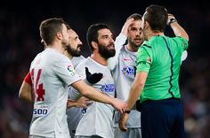 (L-R) Gabriel 'Gabi' Fernandez, Juan Francisco 'Juanfran' Torres, Arda Turan and Mario Suarez of Club Atletico de Madrid argue with referee Jose Luis Gonzalez during the Copa del Rey Quarter-Final First Leg match between FC Barcelona and Club Atletico de Madrid at Camp Nou on January 21, 2015 in Barcelona, Catalonia.