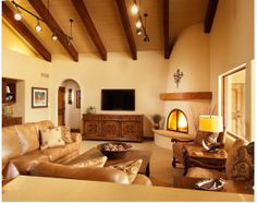wood mantle accent on adobe fireplace, I like the screen on the fireplace