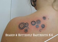 buttons tattoo....but with colors. I think I found my next tattoo. I like the placement as well.