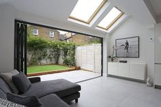 A beautiful classic pitched to hip roof kitchen extension in Tooting. The rear part of the extension was built out far enough to accommodate not only skylights down the side . Extension Veranda, Conservatory Extension, House Extension Design, Glass Extension, Extension Ideas, Building Extension, Conservatory Roof, Open Plan Kitchen Diner, Kitchen Diner Extension