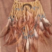*made to order and may have subtle differences to photo shown above*  deer skin embellished with small teal and silver beads with feathers. Perfect for an authentic native american look or special occasion. Metal concho in the center.  12 inches from top of leather piece to bottom of leather ...