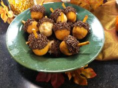 adorable 'acorns' made from plain donut holes, choc or hazelnut icing,chocolate sprinkles and a pretzel stick stem. so easy, so cute!