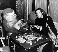 Bela Lugosi playing poker with Santa, 1940