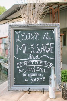 Wedding Sign for your Nautical Wedding.  Pinned by Afloral.com from http://ruffledblog.com/ruffled_galleries/intimate-rustic-wedding/erin-dan-wedding-363/ ~Afloral.com has chalkboards and vintage  bottles for this adorable beach wedding idea.