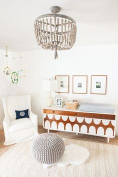 Very light and sophisticated nursery décore. Great DIY dresser/changing table paint!