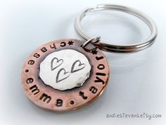 http://www.etsy.com/listing/94577619/copper-and-sterling-silver-hand-stamped