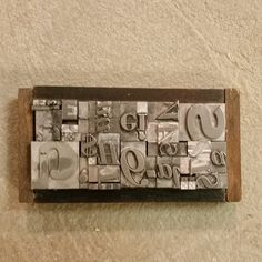 Industrial steampunk one-of-a-kind art made from metal letterpress type framed with spacers.  AWESOME